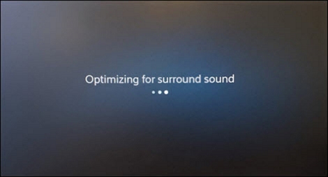 A screen informs the user that it is optimizing the surround sound