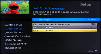 The Set Audio Language screen with English and Spanish options.