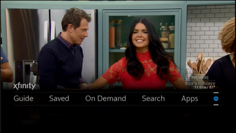 The X1 TV box xfinity Guide menu. The gear icon, representing Settings, is selected.