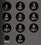 Number pad. Setup button is located in the bottom-left corner to the left of the zero button.